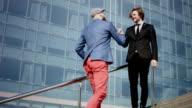Casual business man handshake.
