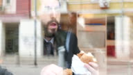 Casual businessman eating fast food