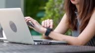 HD DOLLY CU : casual woman use smart watch