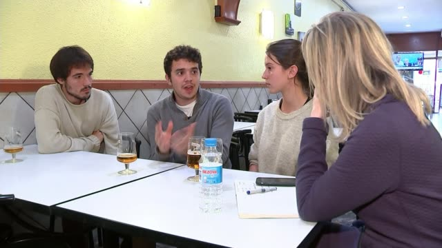 Separatist leader Carles Puigdemont holds press conference SPAIN Barcelona ITN Reporter sitting watching press conference on television at table with...