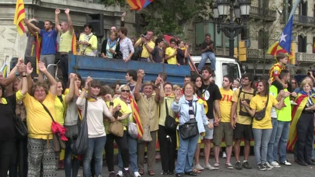 Catalans massed in a vast human chain stretching hundreds of kilometres along the Mediterranean coast on Wednesday demanding independence from Spain...