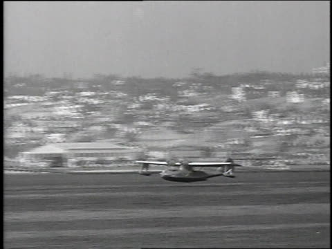 1939 MONTAGE PBY Catalina flying boats taking off / San Diego, California, United States