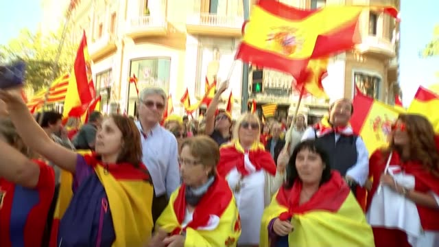 Unity demonstration in Barcelona Barcelona Various of members of large crowd chanting proSpanish songs at antiindependence nationalist demonstration...