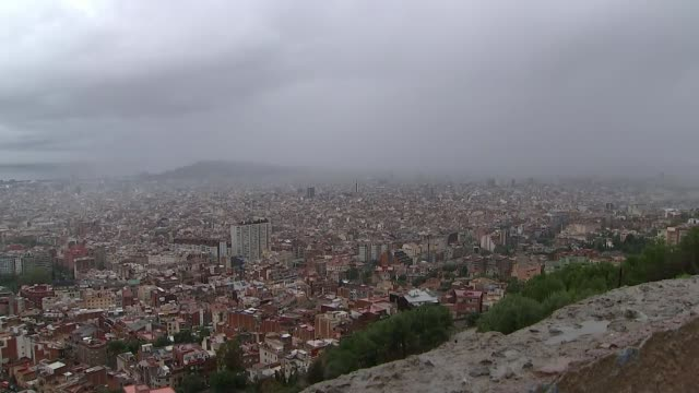 Catalonia refuses to back down over independence SPAIN Catalonia Barcelona EXT Wide shot of Barcelona cityscape with dark clouds overhead Barcelona...