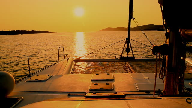 HD: Catamaran Sailing At Sunset