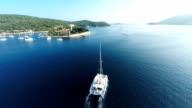 AERIAL Catamaran sailing in the bay