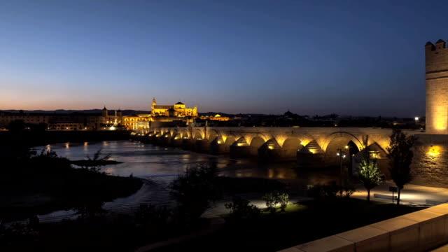 Cathedral Mosque & Roman bridge Cordoba Timelapse Day to Night