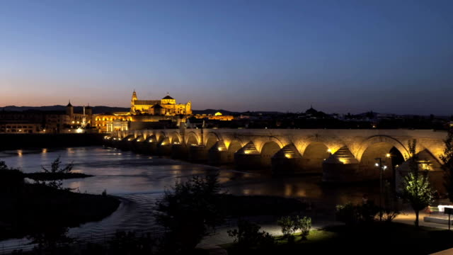 Cathedral Mosque & Roman bridge Cordoba Timelapse Day to Night Zoom