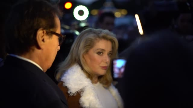 Catherine Deneuve French actress wears a fur coat before the Saint Laurent show during Paris Fashion Week on September 26 2017 in Paris France
