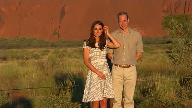 ULURU Catherine Duchess of Cambridge Prince William stand in front of Uluru talk and pose for photos