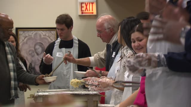 WGN Catholic charities served meal to some 300 homeless men and women on Christmas Eve and Christmas Day People Getting Food Served At Homeless...