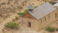 CU AERIAL ZO Catholic cross on exterior of building and town in Chihuahuan Desert / Terlingua, Texas, United States