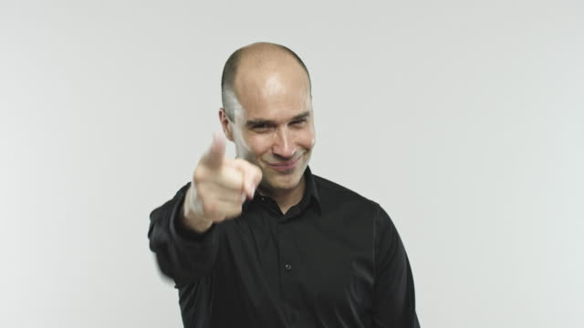 Caucasian adult man pointing at camera