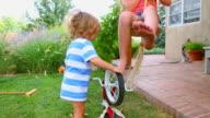 Caucasian children playing in backyard