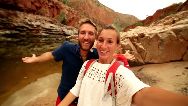 Caucasian couple hiking take a selfie portrait