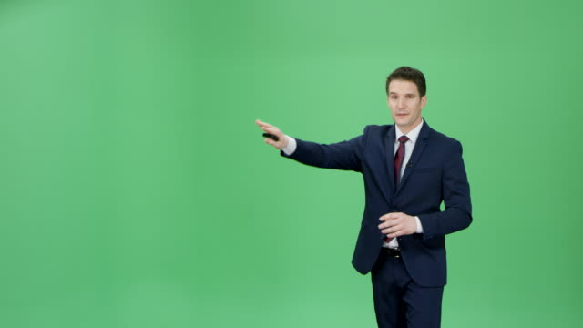 Caucasian man in a dark blue suit presenting the weather forecast