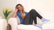 Caucasian woman enjoying her fruit