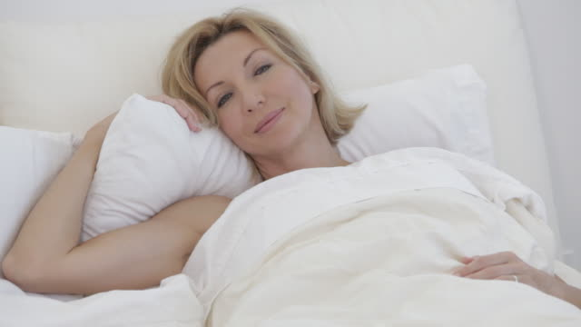 Caucasian woman sleeping in bed