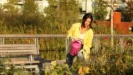 Caucasian woman watering plants in an urban garden