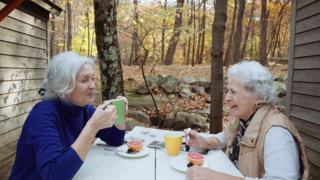 Caucasian women relaxing at outdoor breakfast in autumn