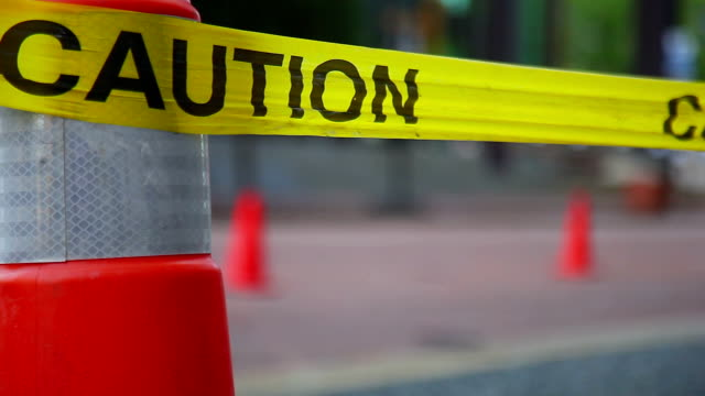 Caution safety tape on the road. Close up