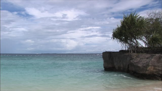 Cebu Sea Rock projecting from the beach Lapping wave
