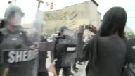 Celebrations continued into Friday evening at the epicenter of Baltimore's recent riots as protesters reacted to news that six police officers will...