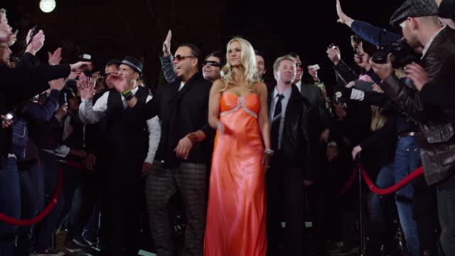 Slo Mo Ms Celebrities Waving As Walking Through Crowd At