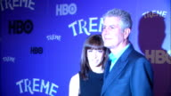 Celebrity chef Anthony Bourdain Ottavia Busia posing for the red carpet at the Museum of Modern Art