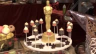 Celebrity chef Wolfgang Puck will offer Oscar nominees a classic American snack with a 'twist' as he unveiled the luxury food to be served this...