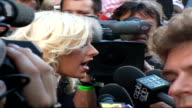 Celebrity red carpet arrivals / interviews Side view of Aguilera speaking to press