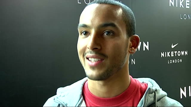 Celebrity sports stars at reopening of Niketown Carl Lewis and Theo Walcott lined up for photocall on starting line Theo Walcott interview SOT...