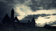 Celtic Tower and Monastery with timelapse clouds