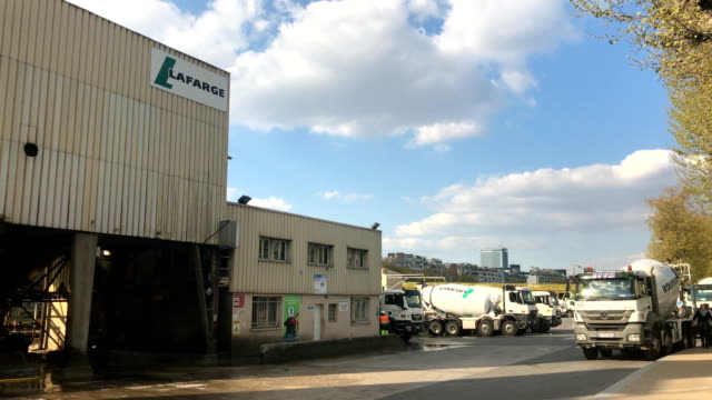 Cement trucks sit outside the cement manufacturer Lafarge in Paris on the banks of the Seine river Lafarge Holcim is a company delivering cement...