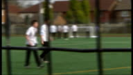 London councils encourage people to respond London EXT Schoolboys playing football INT Close up of hands wearing latex gloves as pick up phial...