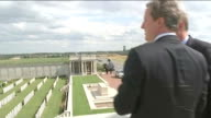 David Cameron visits memorial in Loos FRANCE Picardy Lens LoosenGohelle Dud Corner Cemetery EXT Various of Prime Minister David Cameron MP looking at...