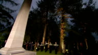 Lanterns laid at German Obelisk in cemetery BELGIUM Mons St Symphorien EXT / NIGHT VIPs along to memorial / Archbishop of Canterbury Justin Welby...