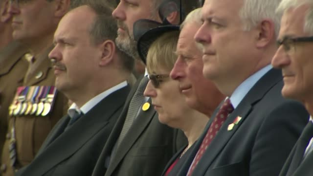 Prince Charles attends Welsh National Service of Remembrance silence being observed / stones being unveiled / Prince Charles laying wreath / Carwyn...
