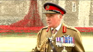 WWI centenary Tower of London poppy installation interview Lord Dannatt ENGLAND London Tower of London EXT General Lord Dannatt interview re...