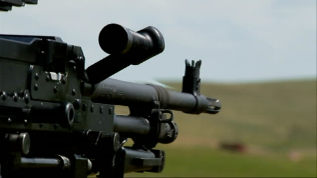 Welsh soldiers remembered WALES Brecon Beacons EXT Close shot gun being fired Back view soldier firing weapon during military training exercise Side...
