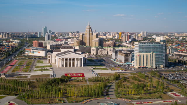 Central Asia, Kazakhstan, Astana, elevated view over the city center and Opera Theater building - Time lapse