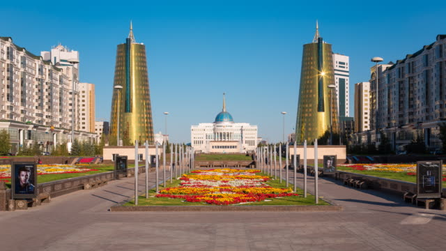 Central Asia, Kazakhstan, Astana, Presidential Palace and the twin golden conical business centres - Time lapse