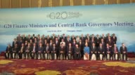 Central bank chiefs and finance ministers from the world's top 20 economies pose for family photo as they meet in the southwestern Chinese city of...