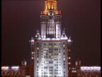 Central Moscow at night Good shots floodlit Moscow University building CAR Kremlin seen from POV of moving car / Brightly lit luxury designer...
