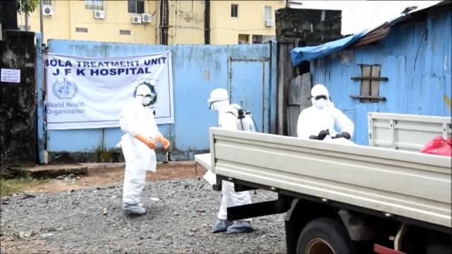 A centre for health workers in the Liberian capital Monrovia provides protective clothing for teams heading out to treat suspected Ebola sufferers