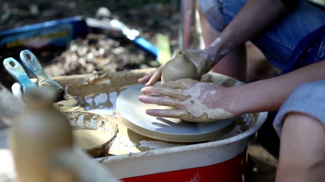 Ceramist making a pot