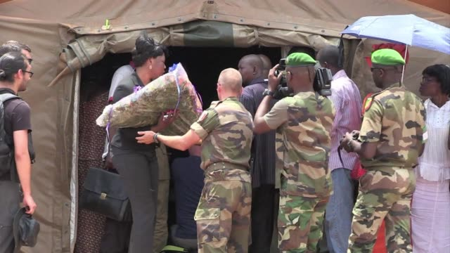 A ceremony took place at a French military facility in Bangui Centrafrica before the body of slain French photographer Camille Lepage was flown back...