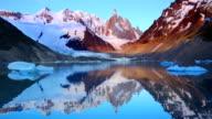 Cerro Torre, Patagonia, Argentina reflected in lake below, at sunrise