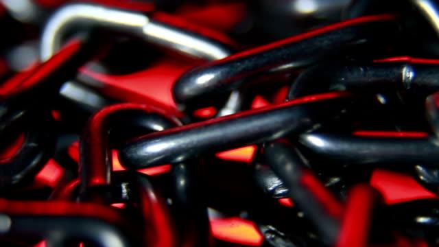 Kette in rotes Licht, Endlos wiederholbar Hintergrund