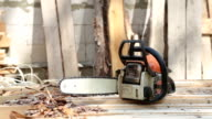 Chainsaw on wooden planks.